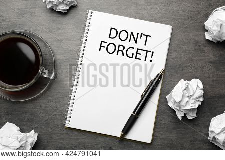 Reminder Don't Forget Written In Notebook On Grey Table, Flat Lay
