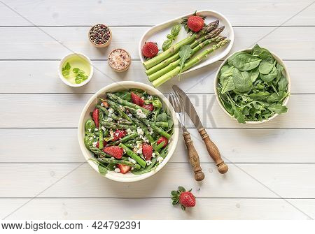 A Healthy And Delicious Salad Made From Fresh Strawberries, Green Asparagus, Feta Cheese With Vegeta