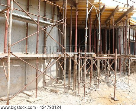 Many Scaffolding Of The Construction Site During The Reconstruction Of A Building With Innovative Ma