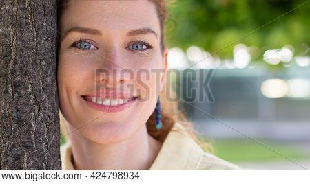 Beautiful Natural Caucasian Woman In Park Closeup