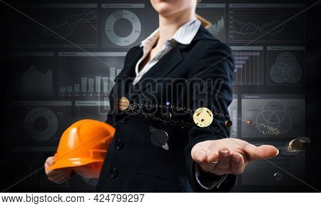 Businesswoman Holds In Palm Solar System 3d Model. Woman In Business Suit With Orange Safety Helmet.
