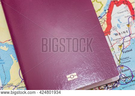 Red Passport Over Usa Map. Focus On The New England North American Continent. Emigration, Travel, De