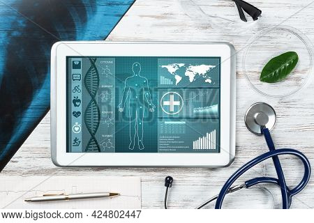 Human Genetic Research In Medical Laboratory. Tablet Computer With Dna Helix Structure On Screen. St