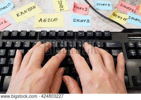 Hand Working In Keyboard, Software Scrum Agile Board With Paper Task, Agile Software Development Met
