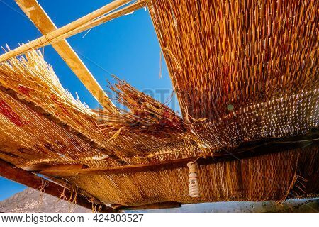 The Hole In The Straw Roof And The View Of The Blue Sky On The Tourist Stop Near Bedouin Settlement