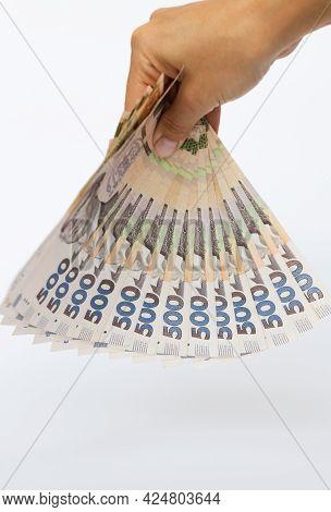 Ukrainian Money In A Hand. Ukrainian 500 Banknotes.