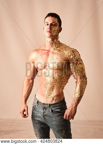 Muscular Young Man Covered With Golden Specks