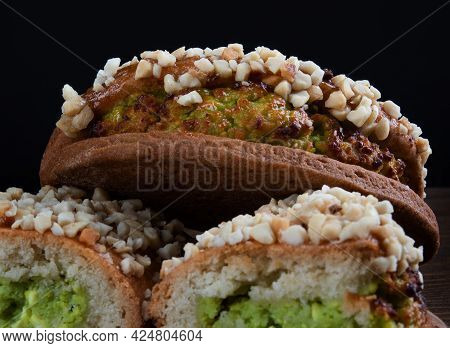 Delicious Cut Pastries With Pistachio Curd And Nuts On A Dark Background.