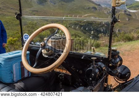 Franschhoek, South Africa - April 12, 2021: Wooden Steering Wheel Of A Model-t Ford From 1915. Frans