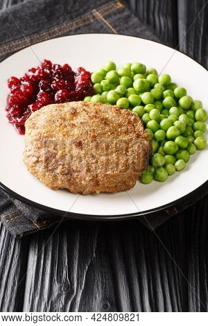Swedish Food Veal Burgers Wallenbergare With Green Peas Closeup In The Plate On The Table. Vertical
