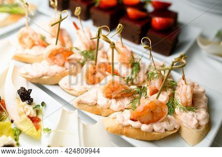 View Of Plate With Appetizer Canape With Shrimp And Sauce And White Bread