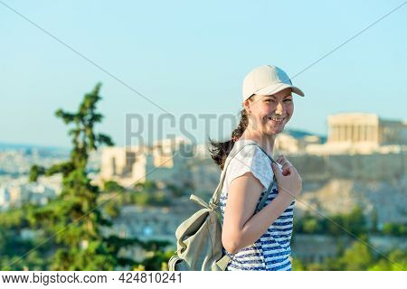 Enjoying Vacation In Greece. Young Traveling Woman Enjoying View Of Athens City And Acropolis.