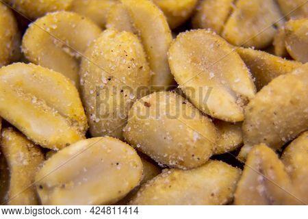 Peanuts With Coarse Salt, Macro Shot, Peanut Background For Designer. Nuts, Snacks.