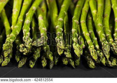 Asparagus. Fresh Green Asparagus On Black Background. Healthy Vegetable Diet. Vegetarianism. Top Vie