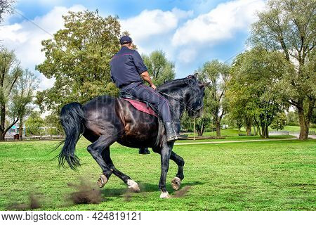 Abakan, Russia - August 21, 2018: A Policeman On Horse Patroling In A Park In Summer.