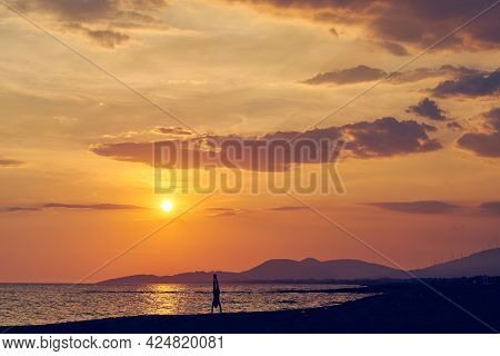 Man doing yoga in nature. Yoga in nature. Yoga lifestyle. Healthy lifestyle. Man doing yoga on beach in sunset. Yoga healthy yoga lifestyle. Happy people doing yoga. Healthy people. Young people. Yoga outdoors in nature on beach. yoga