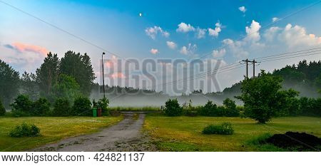 Late Evening Sky Mist And Lawn In June