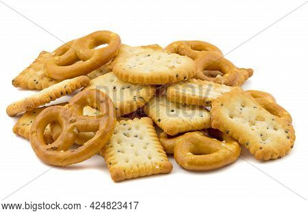 A Small Pile Of Party Snacks Crackers And Pretzels Isolated On A White Background