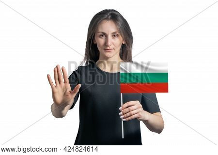 Happy Young White Woman Holding Flag Of Bulgaria And With A Serious Face Shows A Hand Stop Sign Isol