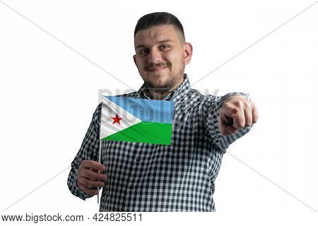 White Guy Holding A Flag Of Djibouti And Points Forward In Front Of Him Isolated On A White Backgrou