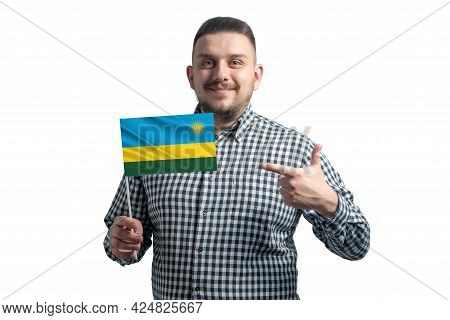 White Guy Holding A Flag Of Rwanda And Points The Finger Of The Other Hand At The Flag Isolated On A