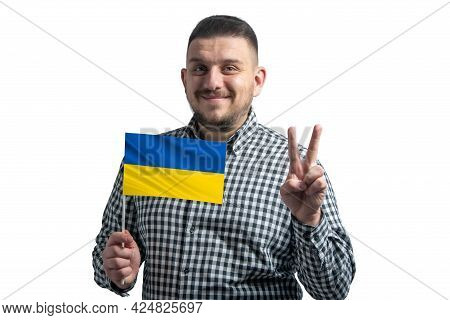 White Guy Holding A Flag Of Ukraine And Shows Two Fingers Isolated On A White Background.