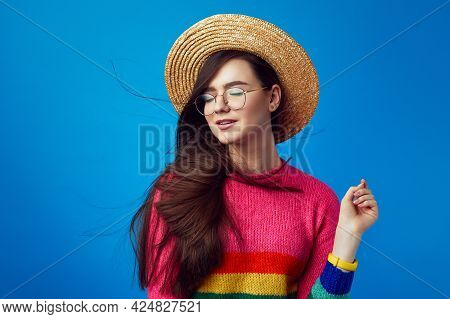 Girl Wearing Straw Hat, Closes Eyes From Pleasure While Wind Blowing Hair