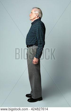 Senior man in a tartan scott shirt