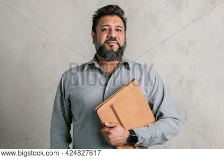 Proud Indian man carrying a laptop pouch