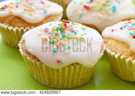 Sprinkle Fairy Cakes Topped With Light Icing Sugar And Colourful Sprinkles.