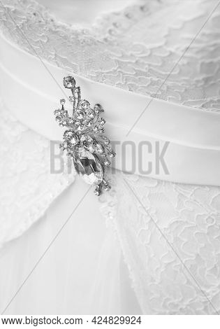 Decoration Brooch With Diamonds On The Wedding White Dress Of The Bride, Close-up.