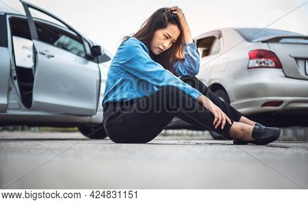 Asian Business Woman Sitting On The Floor, She Stressed And Wait For Notify Insurance Agents From Th