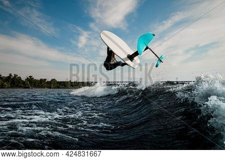 Marvelous View Of Foilboard On Which Man Effectively Performs Trick Over The Wave