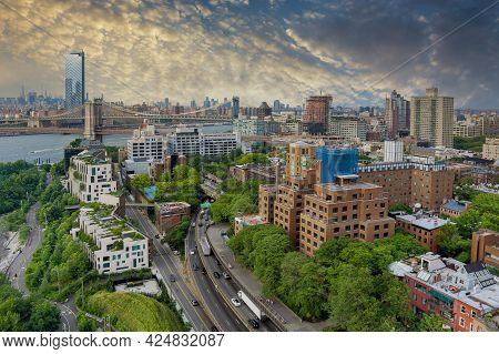 Panorama View On Skyline Of Manhattan The Brooklyn And Manhattan Bridges Across Hudson River In New