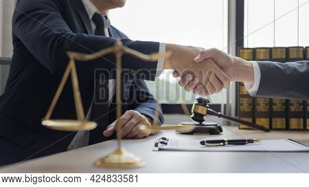 Businessman shaking hands with a lawyer or judge After signing the contract and the agreement is com