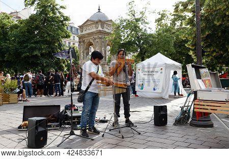 Paris, France - June 21, 2021 : Street Musicians Entertain Tourists In Les Halles Quarter In Paris.
