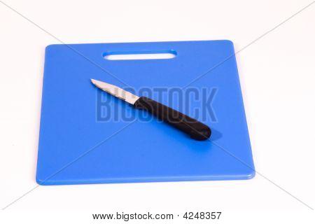 Paring Knife On Blue Cutting Board
