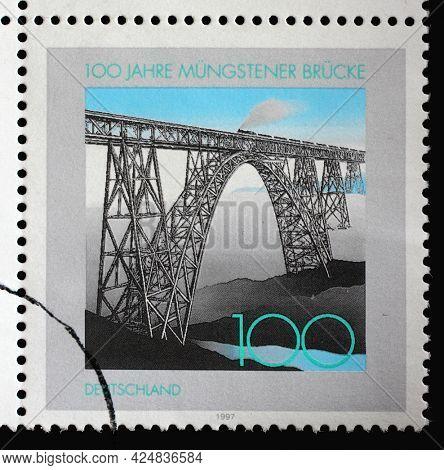 ZAGREB, CROATIA - AUGUST 29, 2014: A stamp printed in Germany shows Train on Müngsten Railway Bridge, Centenary of Müngsten Railway Bridge, circa 1997