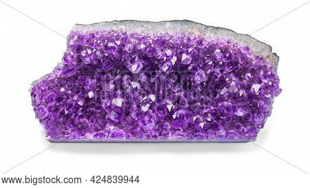 A Large Purple Amethyst Nugget On A White Isolated Background.