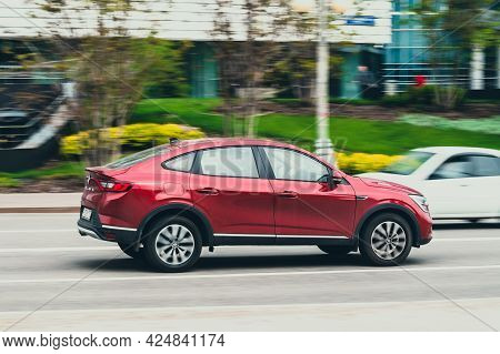 Red Renault Arkana Suv Driving In Moscow City. This Is First Compact Crossover With A Sloping Rear R
