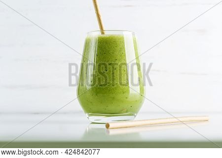 Green Smoothie From Spinach, Apple, Cucumber And Soy Milk In Glass On White Background. Home Cooking
