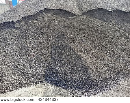 A Pile Of Gravel On The Dock Ready To Be Loaded Onto The Ship. Bulk Cargo In A Heap At The Berth For