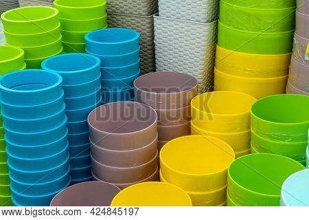 Pots Of Flower Pots On The Shelf In The Store. Colorful Pots