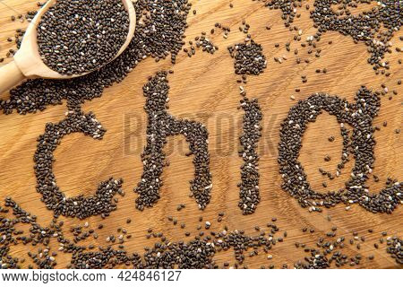 Chia Seeds. Chia Seeds In A Wooden Spoon Close-up. Slimming, Health Care Product