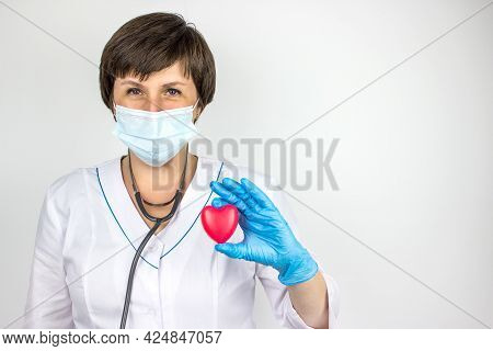 Ambulance. Cardiology Healthcare. Medicine Doctor Holding Red Heart Shape In Hand. Health Care And P