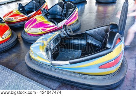 Colorful Bumper Cars, Racing Cars In Amusement Park, Racing With Bumps.