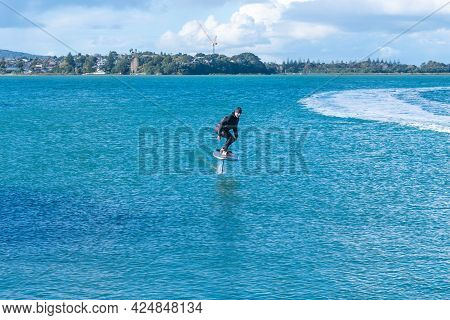 Auckland New Zealand - June 17 2021;foil Board Being Towed Behind Jet-ski On Auckland Harbor Stanley
