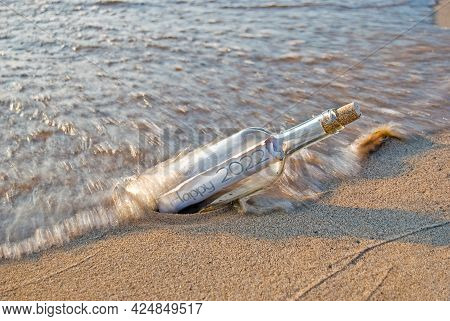 New Year 2022 Message In A Bottle On A Beach