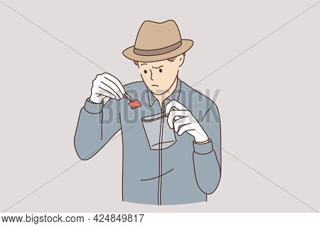 Detective With Evidence Working Concept. Young Serious An Working As Detective In Hat Putting Piece