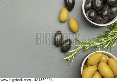 Black And Green Olives. Bella Di Cerignola Italian Olives. Colored Olives And A Sprig Of Rosemary Li